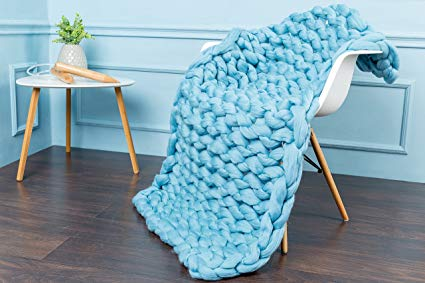 blue arm knitting blanket on a chair