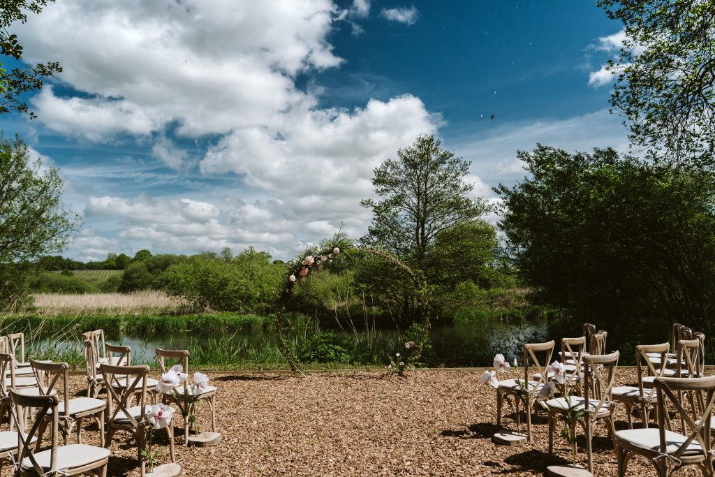 outdoor wedding ceremony by lake