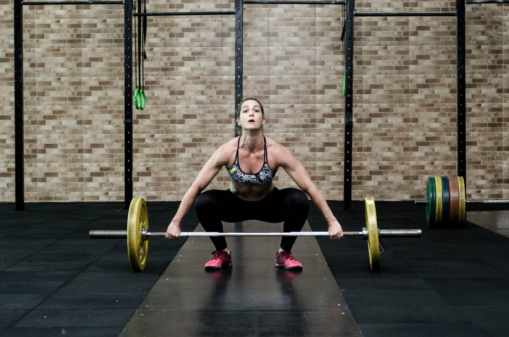 woman weight lifting HerHampshire