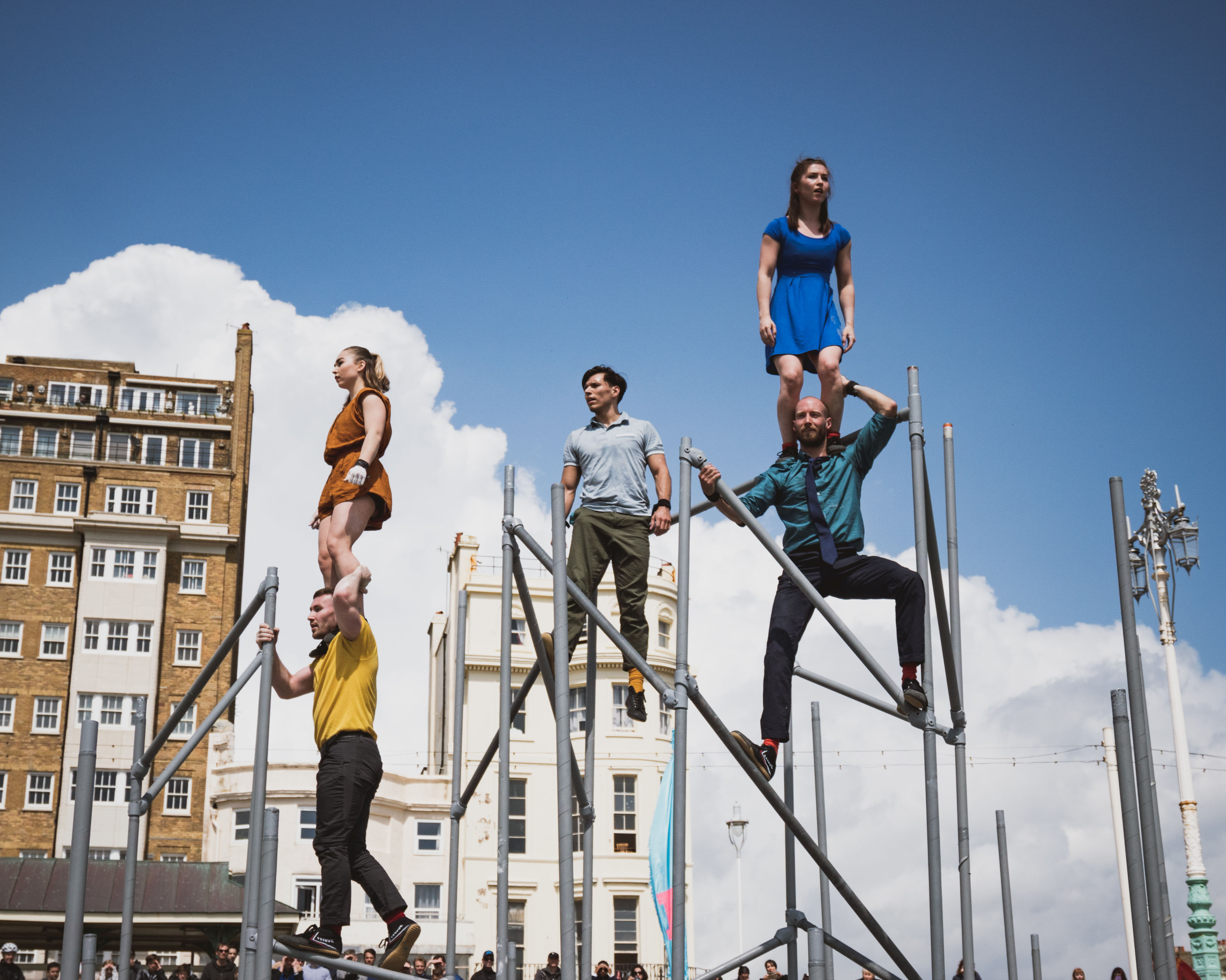 5 performers on scaffolding