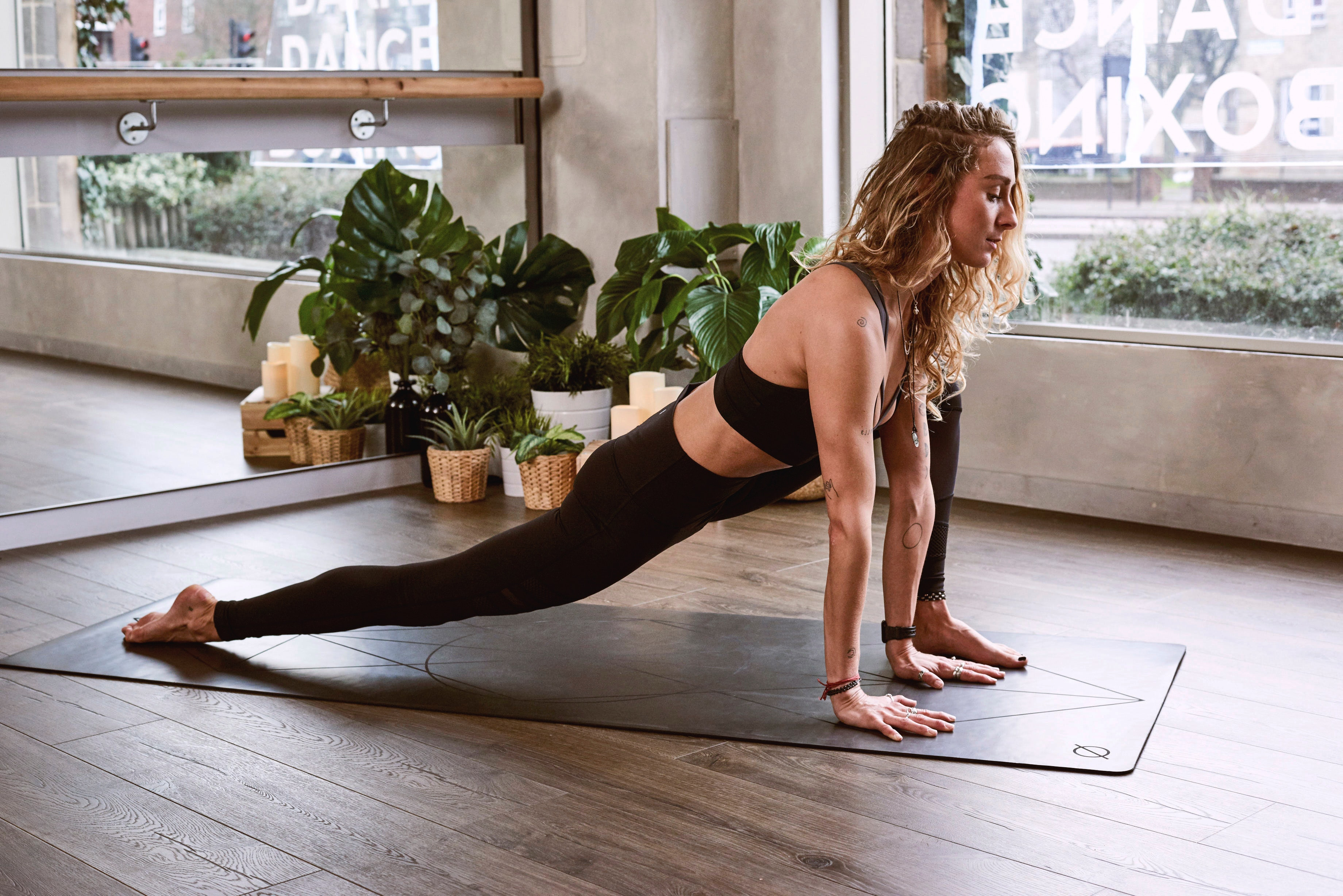 yoga and pilates stretch on mat