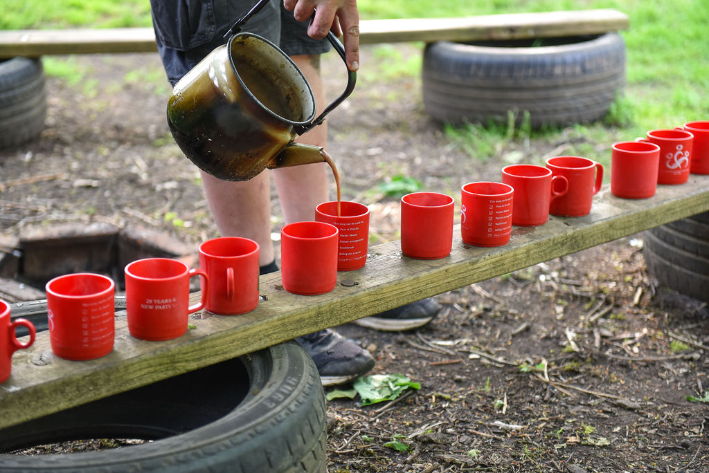 Pouring tea in cups at Forest School