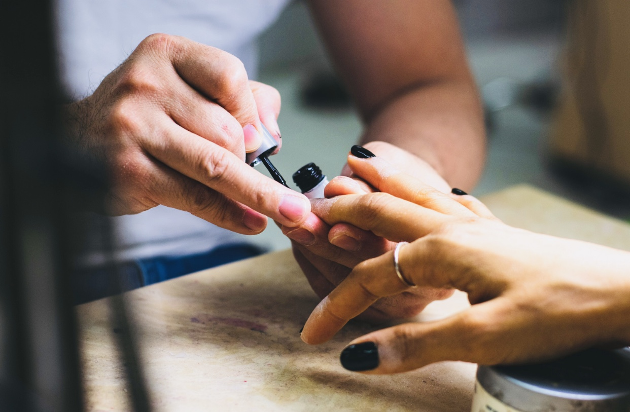 Having a nail manicure