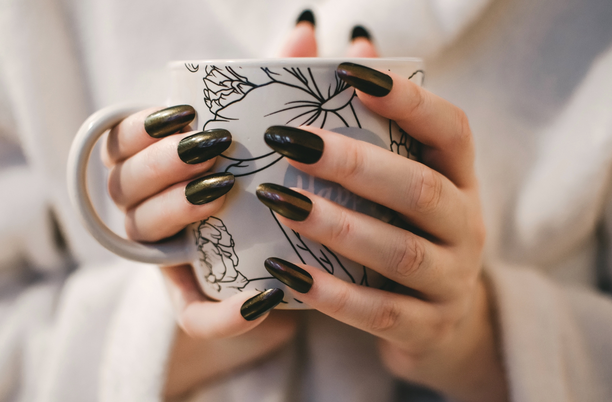 Nails around a coffee cup